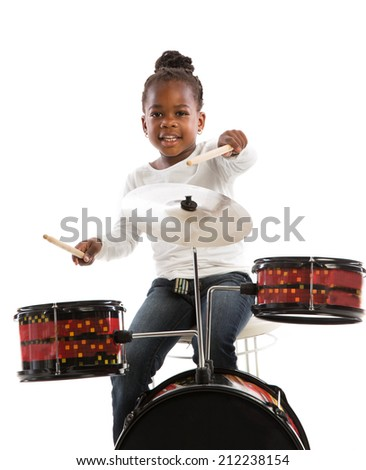 Four Year Old African American Girl Playing Drum Set Isolated on White Background