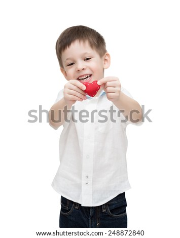 Four-year-old boy holds small heart, isolated on the white - stock photo