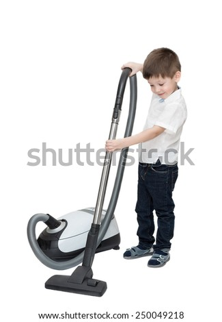 Four-year-old boy is cleaning room with vacuum cleaner isolated on white - stock photo