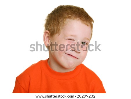 Four-Year-Old Boy making a Winking Face - stock photo
