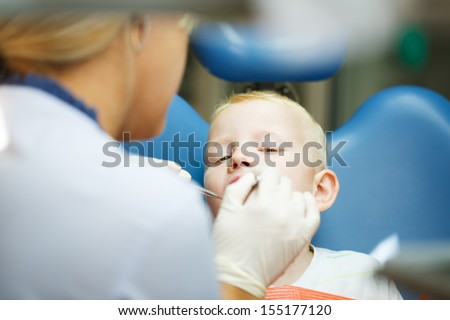 Four year old boy visits the dentist at her office for a check up.