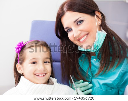 Four year old girl visits the dentist at her office for a check up  - stock photo