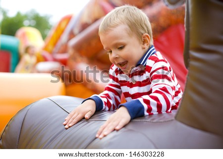 Four-year-old kid playing on a trampoline  - stock photo