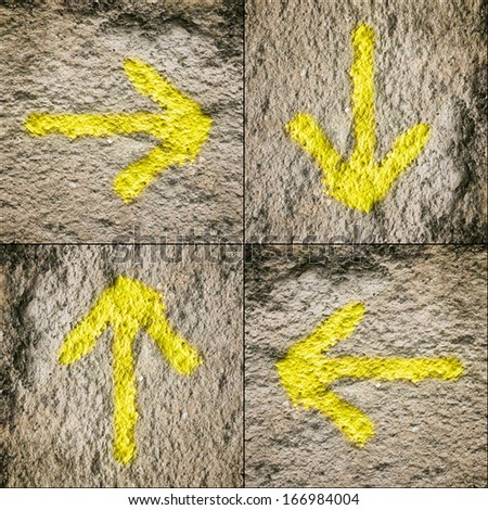 Four yellow arrows on wall background in square composition