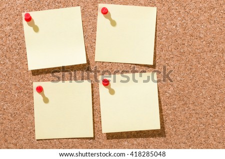Four yellow blank square-shaped notepads pinned on cord board; Keep in mind; Write down your ideas