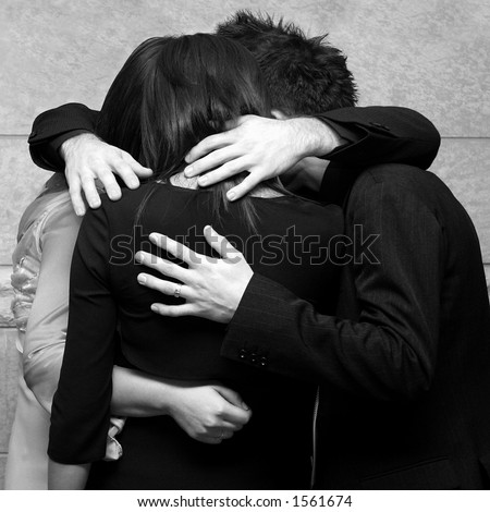 Four young friends holding each other in a privat moment - stock photo