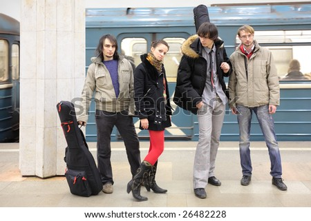 Four young musicians at metro station - stock photo