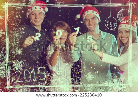 Four young people celebrating New Year, holding card numbers 2015 - stock photo