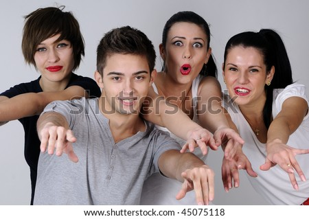 four young people communicating - stock photo