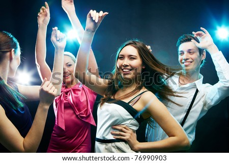 Four young people dancing energetically