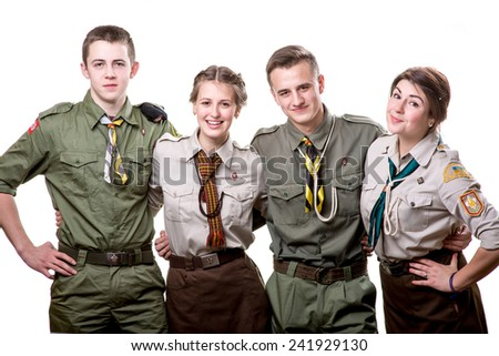 Four young scout members embracing in uniform isolated on white background - stock photo