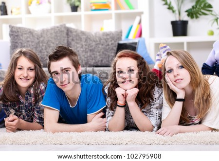 Four young students lined up for a portrait. - stock photo