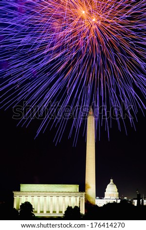Fourth of July celebration with fireworks exploding over the Lincoln Memorial, Washington Monument and U.S. Capitol, Washington D.C. - stock photo