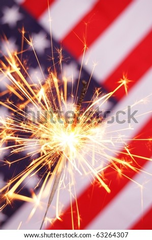 fourth of july concept with sparkler and usa flag - stock photo