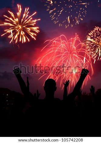 Fourth of July Fireworks celebration concept with cheering crowd. - stock photo