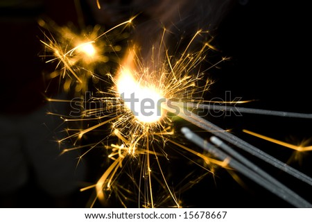 Fourth of July Sparklers are lit - stock photo