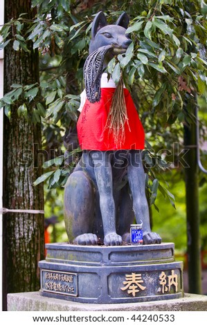 Fox statue in Fushimi Inari-taisha Shrine in Kyoto Japan - The fox is seen as the messenger of the god of grain food