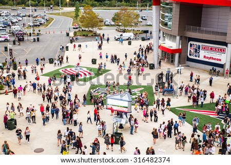 FOXBORO, MASSACHUSETTS - SEPTEMBER 12, 2015:  Fans await entry into Gillette Stadium, home of the New England Patriots,  for the One Direction concert.  - stock photo