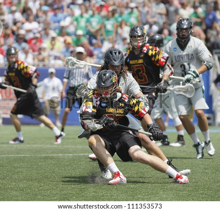 FOXBOROUGH - 28 MAY: Dan Noskin (38), Maryland, defends the ball against Josh Hawkins (5), Loyola, at the NCAA Men's Division 1 Lacrosse Championship game in Foxborough, Massachusetts, 28 May 2012.