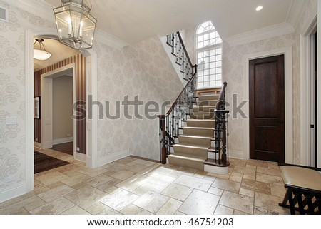 Foyer in luxury home with second story window - stock photo