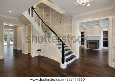 Foyer in new construction home with curved staircase - stock photo