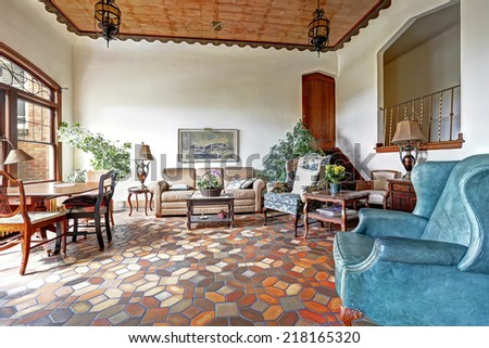 Foyer in old residential building in Downtown, Seattle. Mosaic tile floor, decorated ceiling and antique furniture merge a visitor into historic atmosphere - stock photo