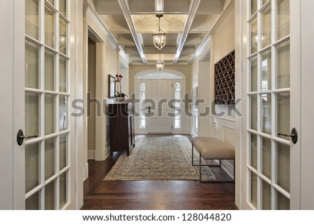Foyer in upscale home with french doors - stock photo