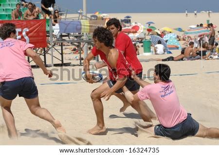 Foz do Arelho - August 09: Beach games -  4th Beach Rugby 2008 (POR) Mens Game, August 09, 2008 in Foz do Arelho, Portugal - stock photo