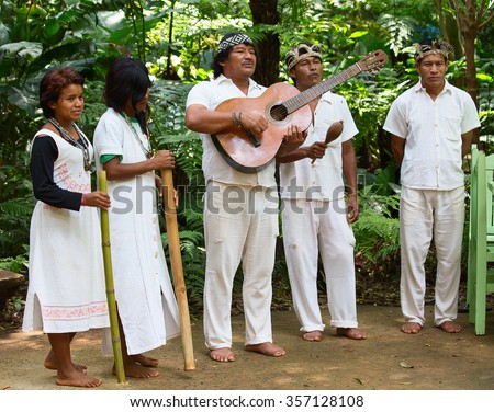 FOZ DO IGUACU, BRAZIL, NOVEMBER 25: Brazilian Guarani Indian people performing traditional songs in the Iguacu National Park, Brazil 2015 - stock photo