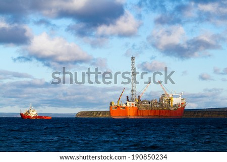FPSO oil production vessel and supply ship. - stock photo