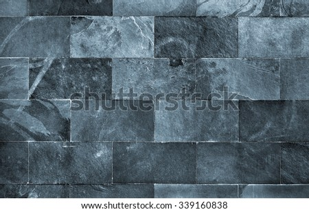 Fraction of a dark schist wall with brick texture - stock photo