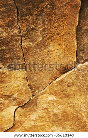 fractured cliff surface - stock photo