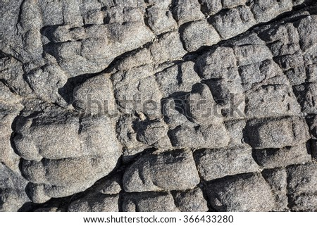 Fractured rock background - stock photo