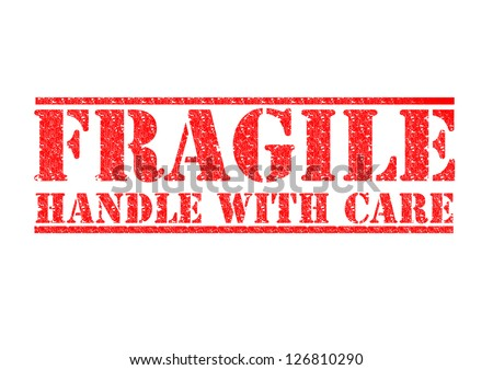 FRAGILE - HANDLE WITH CARE red rubber stamp over a white background. - stock photo