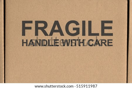 Fragile handle with care warning sign label tag on a cardboard box