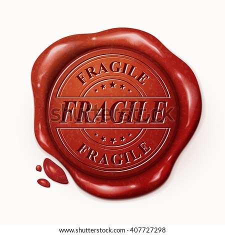 fragile red wax seal over white background