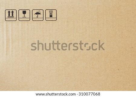 Fragile symbol on cardboard - stock photo