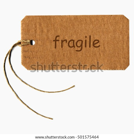 fragile tag with string isolated over white