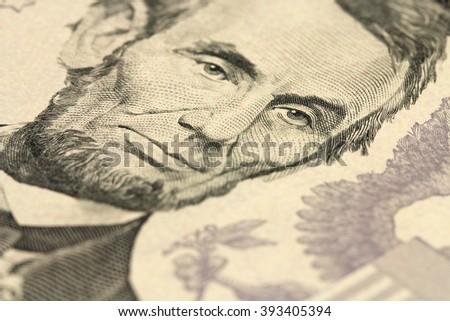 fragment bills in five American dollar background - stock photo