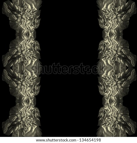 Fragment gold silk cloth on the black background. - stock photo