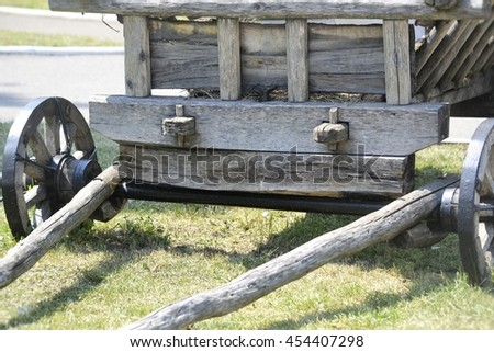 fragment is not drawn by wooden carts with wooden wheels and shafts closeup rural motifs front view