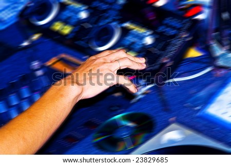 Fragment like photo of dj  getting buisy with his job - stock photo