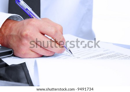Fragment like picture of businessman signing some papers