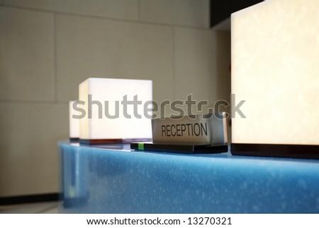 Fragment like shot of reception desk in hotel lobby - stock photo
