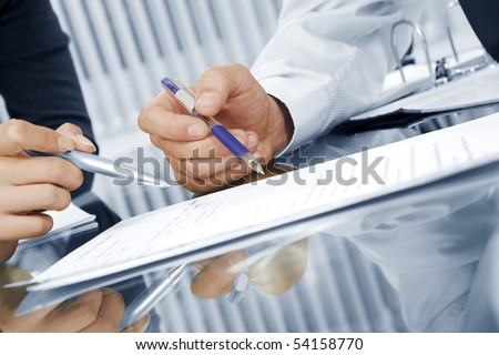Fragment like view of business people  discussing project in office environment - stock photo