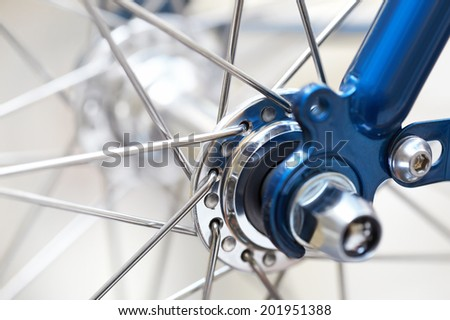 fragment of a bicycle wheel with shallow depth of field - stock photo