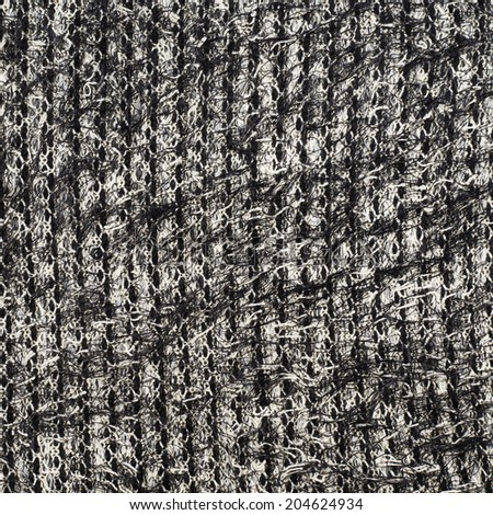 Fragment of a black and white cloth fabric as a background texture - stock photo