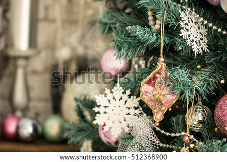 Fragment of a Christmas tree with ornaments and snowflakes. Background for Christmas cards