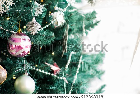 Fragment of a Christmas tree with ornaments. Background for Christmas cards