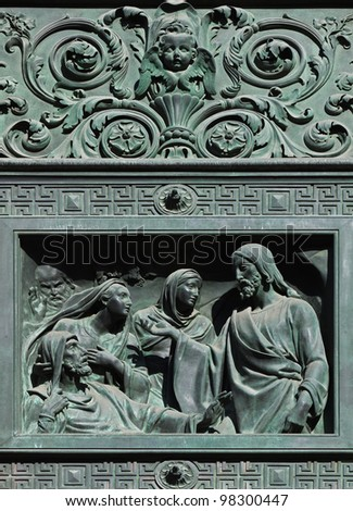 Fragment of a door of  western facade Isaak Cathedral in St. Petersburg, Russia. The Raising of Lazarus. The relief of the caisson top Western front doors. I.P.Vitali architect (1794-1855).
